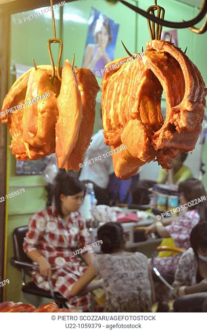 Siem Reap (Cambodia): meat sold in front of a beauty parlour at the central market