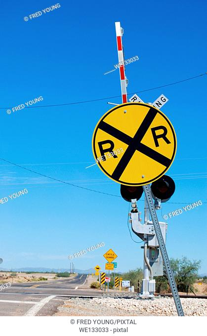Railroad crossing sign with the gates up