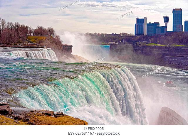 Niagara Falls from the American side and Skyscrapers from a Canadian side. A view on American Falls, Bridal Veil Falls, Goat Island