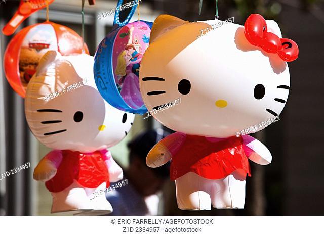 toys for children hanging on market stall Cadiz