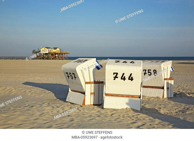 Morning on the Große Sandbank in front of Sankt Peter-Ording, beach chairs with the pile dwelling of the Cafe'54 Grad