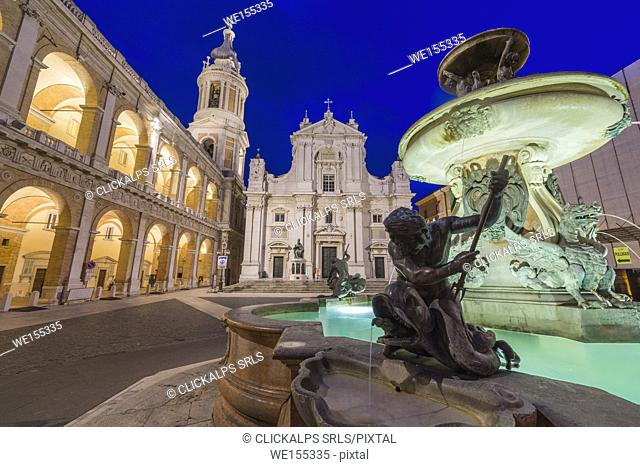 Night view of the Basilica of the Holy House and fountain decorated with statues Loreto Province of Ancona Marche Italy Europe