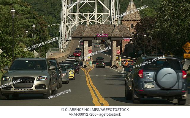 FORT MONTGOMERY, NY - SEPTEMBER 3: Traffic passes through the toll plaza for the Bear Mountain bridge on September 3, 2013 in Fort Montgomery