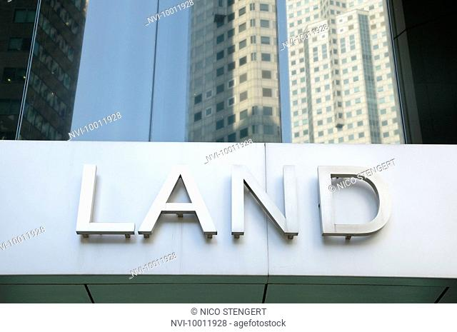 Lettering on a skyscraper, central business district, Singapore, Asia