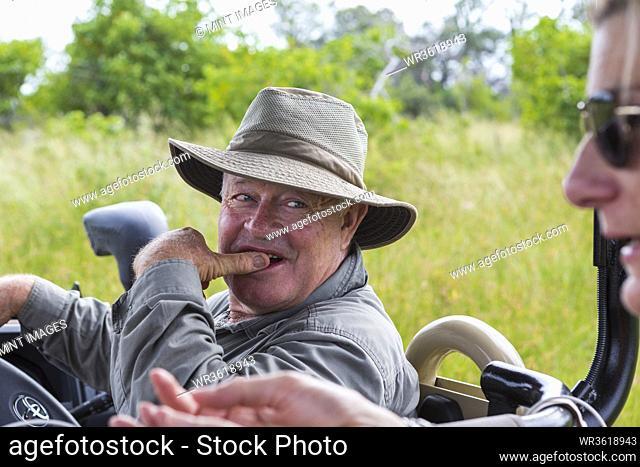 safari guide looking at client, Botswana
