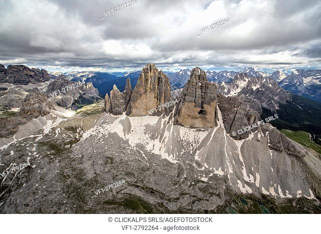 Aerial view of the Three Peaks of Lavaredo on a cloudy summer day. Dolomites. Cadore. Veneto. Italy. Europe
