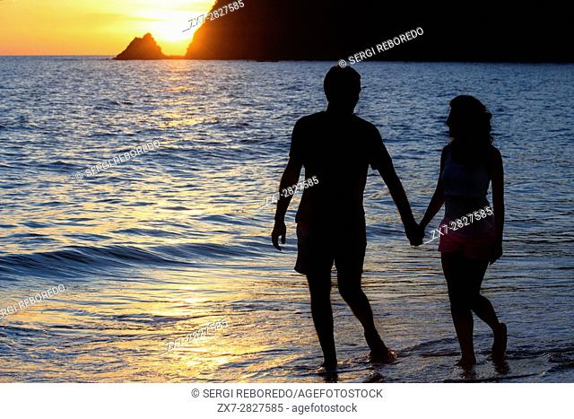 Couple lovers kissing at sunset in the beach. Kantiang Bay. Koh Lanta. Thailand. Asia. Kantiang Bay is most famous as the location of Pimalai, Koh Lantaâ