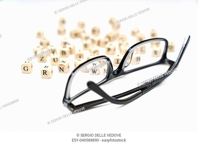 a pair of glasses between the letters of the alphabet