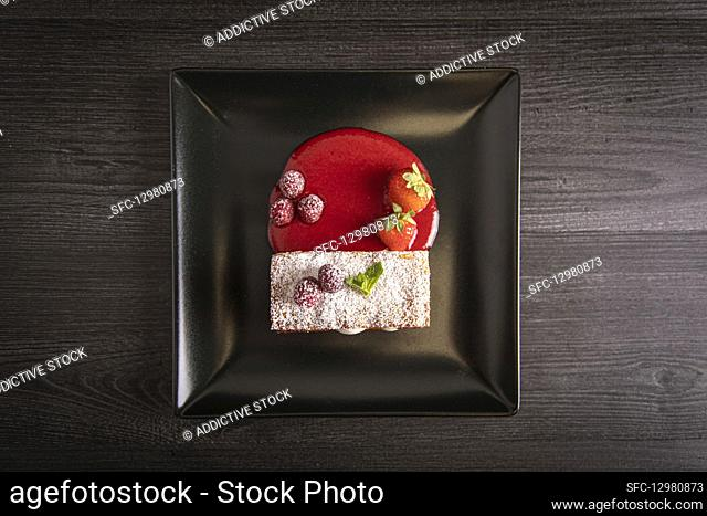 Diphlomate cream and red fruit strudel in elegant black plate