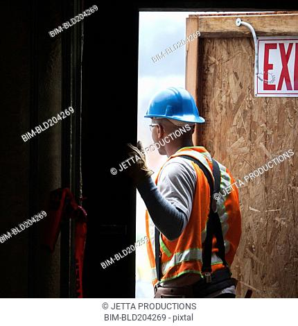 African American worker standing in doorway