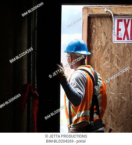 African American worker standing in doorway