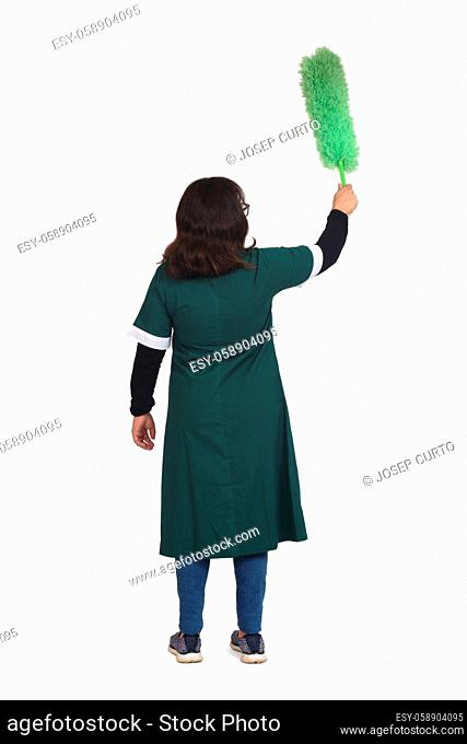 rear view of a latin woman dusting with a duster on white background