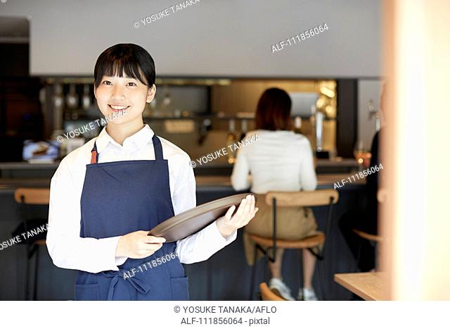 Young Japanese woman working at a restaurant