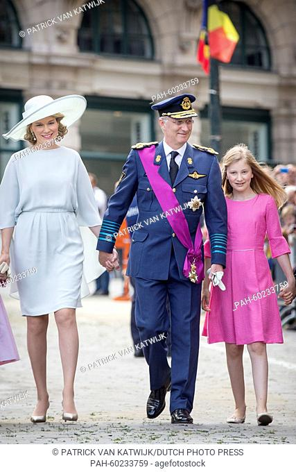 (L-R) Queen Mathilde of Belgium, King Philippe of Belgium and Crown Princess Elisabeth walk together after the Te Deum mass at the Cathedral of St