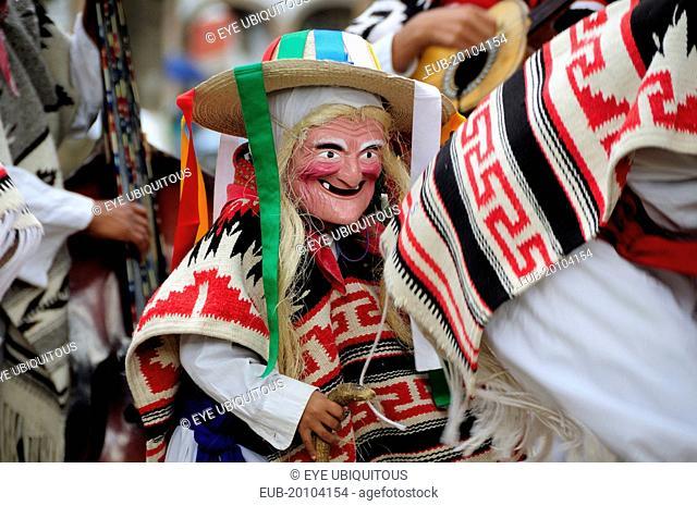 Child wearing mask and costume for Danza de los Viejitos or Dance of the Little Old Men in Plaza Vasco de Quiroga