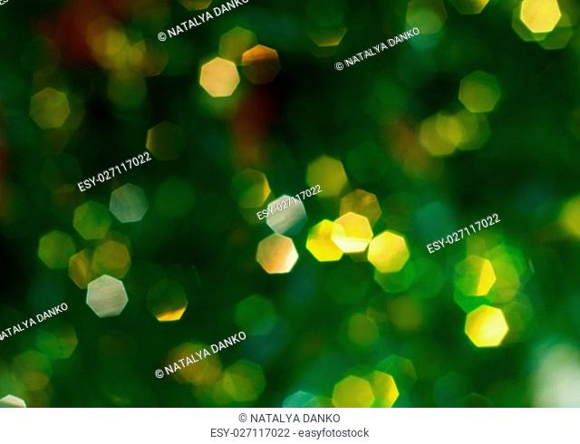 Green background with yellow bokeh, blurred background, full frame