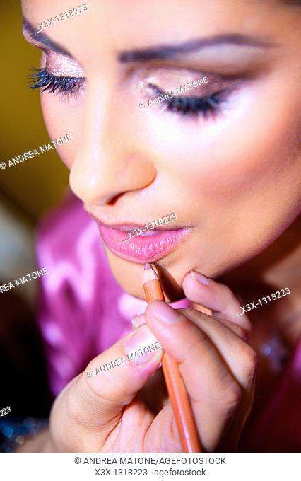 Make up artist applying lips liner