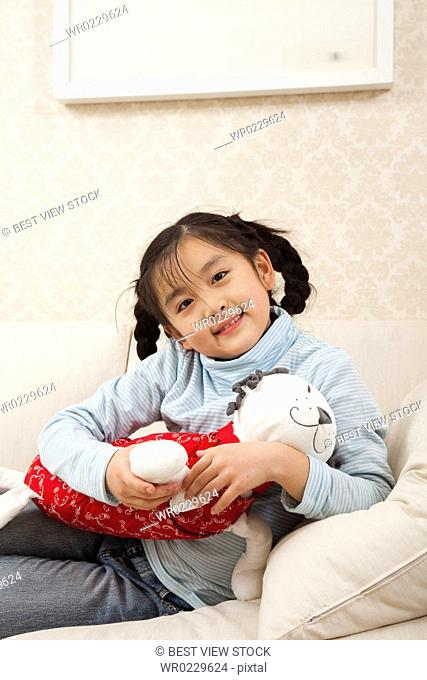 Little girl in leisure time