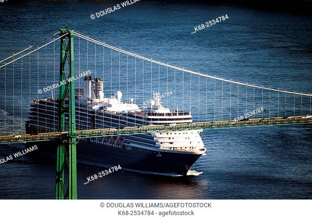 A cruise ship leaves the port of Vancouver under the Lions Gate Bridge, Vancouver, BC, Canada
