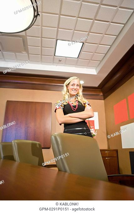 Portrait of young fashionable businesswoman in modern office