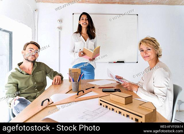 Portrait of confident colleagues having a meeting in architectural office