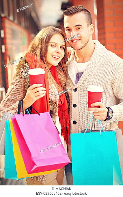 Picture of young couple shopping in the city