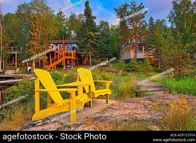 Cottages and Muskoka chairs at Star Lake at sunrise. Cottage Country Living. Whiteshell Provincial Park Manitoba Canada