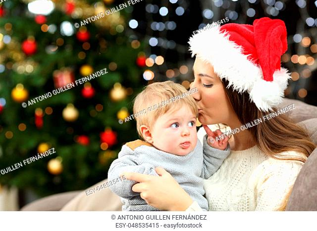 Mother kissing her baby son in christmas