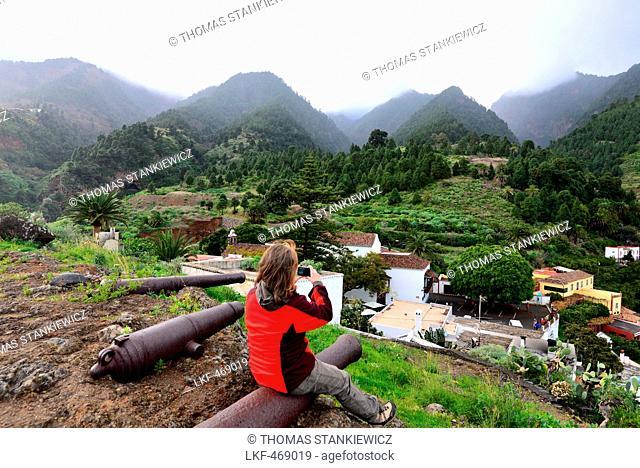 Woman sitting on a gun, Santa Cruz, La Palma, Canary Islands, Spain
