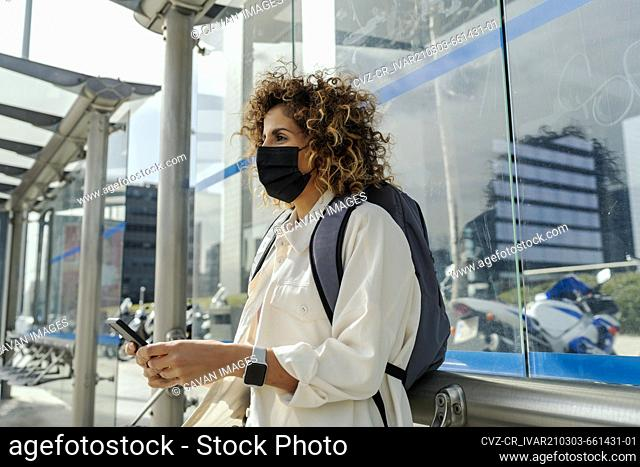 beautiful woman waiting for the bus
