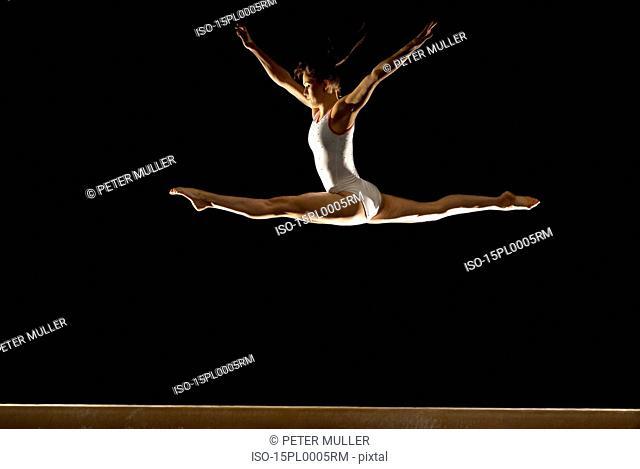 gymnast jumping on beam