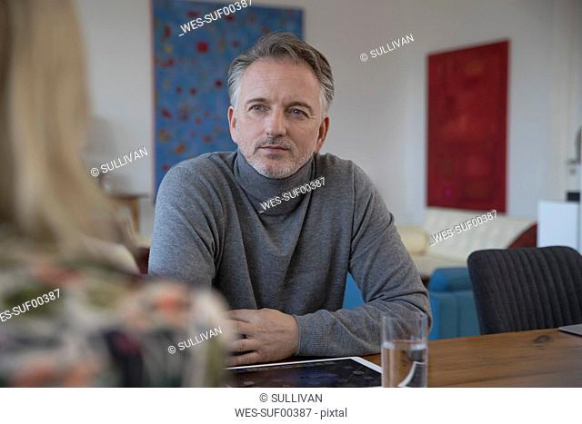 Businessman having a meeting in apartment