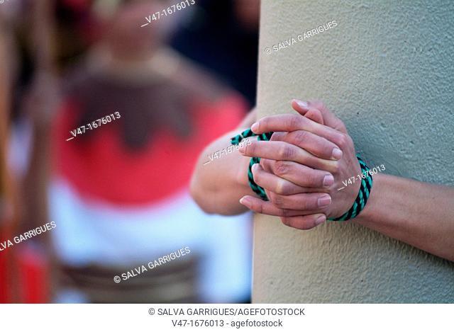 man tied to a column, Alzira, Valencia, Spain, Europe