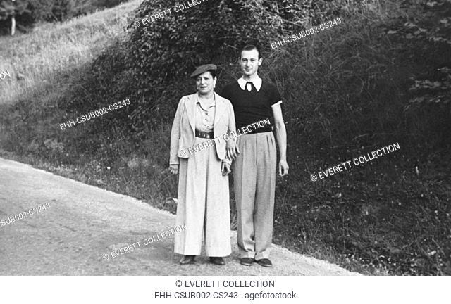 Madame Helena Rubenstein and her oldest son, Roy Titus, in 1937. They were motoring to Brides la Bain, France. Rubenstein was married to Edward William Titus...