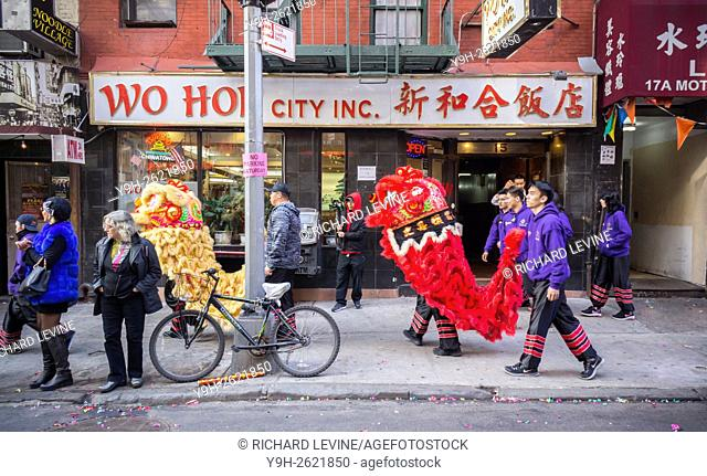 Tourists and New Yorkers of all races and nationalities crowd Chinatown in New York for the continuation of the Chinese New Year festivities