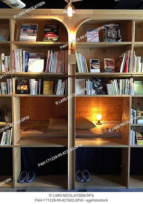 The 'Book and Bed Tokyo', a combination of library and capsule hotel, offers cozy bunks in between wooden bookshelves in Tokyo, Japan, 12 December 2017