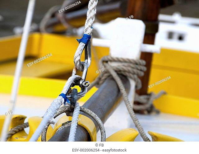 splices on the prow of a sailboat - close view, shackle, rope and loops