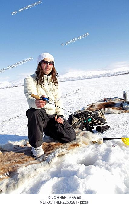 Woman ice fishing