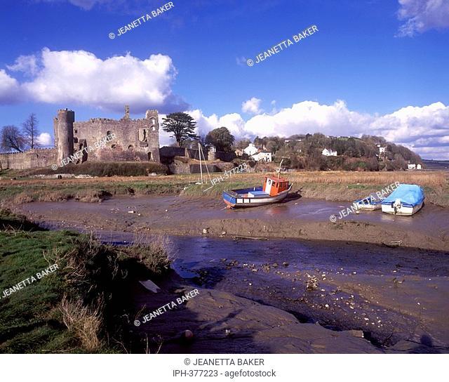 Laugharne Castle at low tide on the Taf Estuary