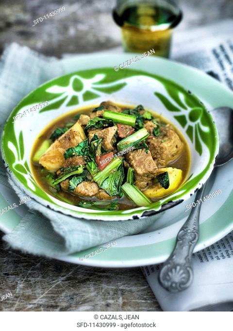 Indian pork curry with leafy greens and lemon