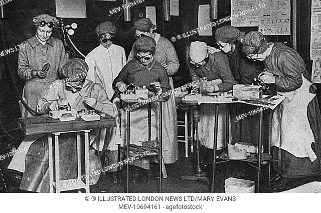 In workshops provided by the London Society for Women's Suffrage women are trained in aeroplane construction. They are pictured using acetylene blow-pipes for...