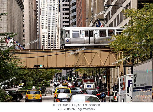 Elevated train known as the L crossing LaSalle Street in Chicago, IL