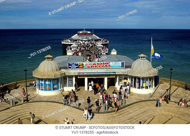 Holidaymakers at the entrance of Cromer Pier over the North Sea, Cromer Seaside Resort, Norfolk, England, UK
