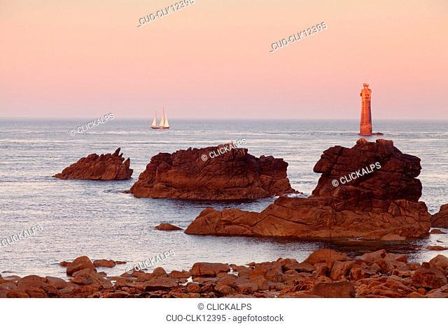 The Jument lighthouse at sunrise, off the island of Ouessant, France, Europe