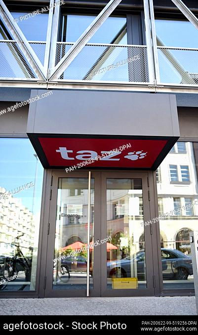 """22 June 2020, Berlin, 12487: The """"""""taz"""""""" logo can be seen at the entrance to the editorial building in Berlin-Mitte. Photo: Sven Braun/dpa"""