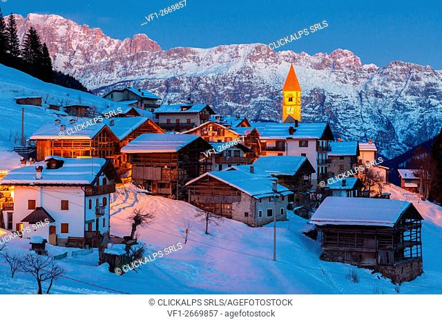 The quaint village of Sappade, municipality of Falcade in the Biois valley, in winter at dusk, Dolomites