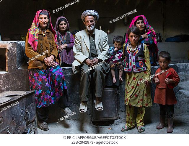 Afghan family inside their traditional pamiri house, Badakhshan province, Wuzed, Afghanistan