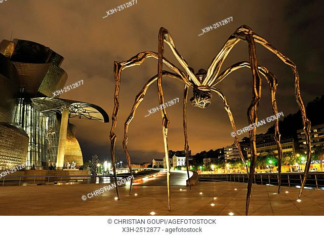 ''Maman'' sculpture by the French-American artist Louise Bourgeois 1911-2010 beside the Guggenheim Museum designed by architect Frank Gehry, Bilbao