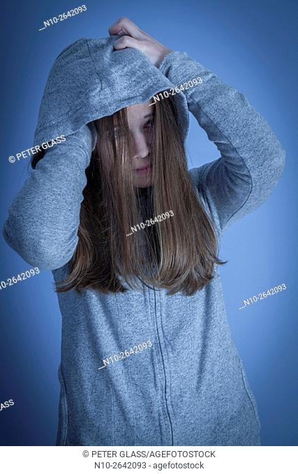 Young woman wearing a sweatshirt and hoodie