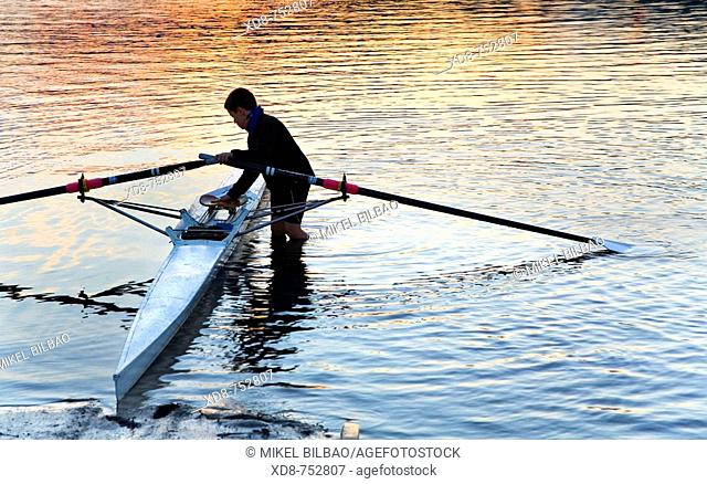 Young canoeist sportman with a canoe, Ason river, Colindres, Cantabria, Spain